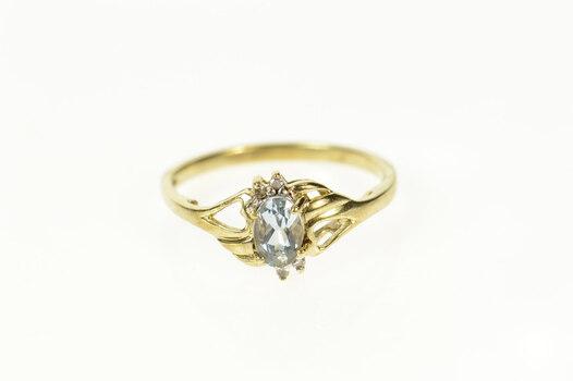 10K Oval Blue Topaz Diamond Bypass Yellow Gold Ring, Size 7