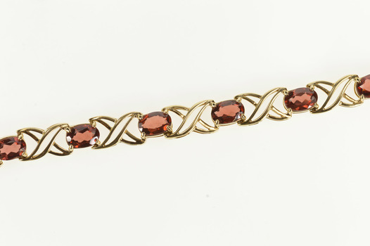 10K Oval Garnet Criss Cross X Link Tennis Yellow Gold Bracelet 7.5""
