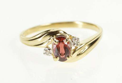 10K Oval Garnet Diamond Accent Bypass Three Stone Yellow Gold Ring, Size 6.75