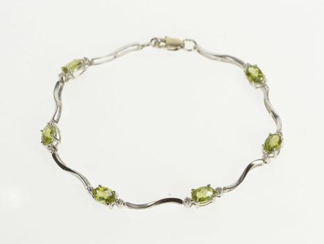 """10K Oval Peridot Diamond Accent Wavy Link White Gold Bracelet 7"""""""