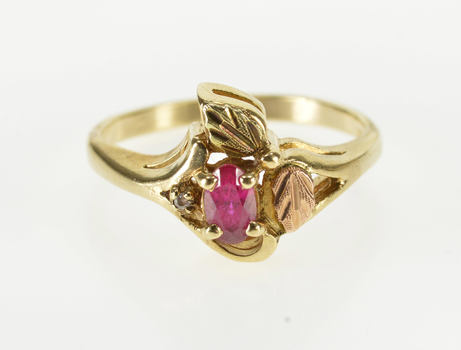 10K Oval Ruby* Inset Diamond Accent Leaf Motif Yellow Gold Ring, Size 5