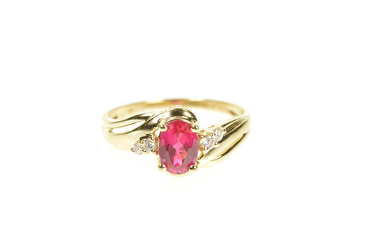 10K Oval Syn. Ruby Cubic Zirconia Accent Bypass Yellow Gold Ring, Size 7