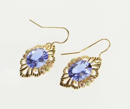 10K Oval Syn. Tanzanite Ornate Leaf Scroll Trim Dangle Yellow Gold Earrings