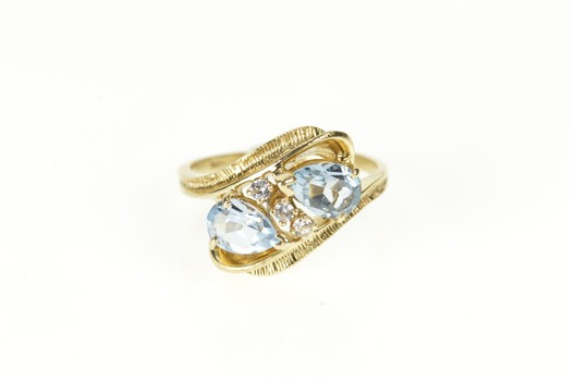 10K Pear Blue Topaz Diamond Accent Bypass Yellow Gold Ring, Size 6.75