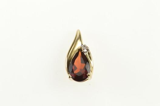 10K Pear Garnet Diamond Accent Wavy Yellow Gold Pendant