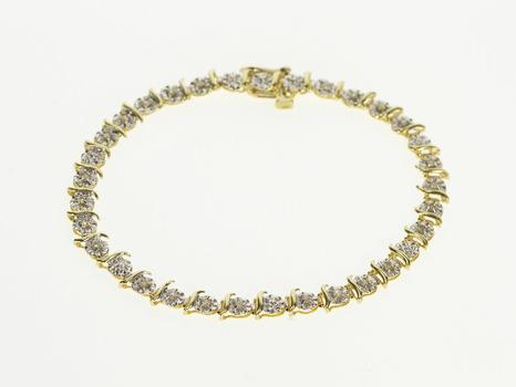 "10K Round Burst Diamond Inset Wavy Link Yellow Gold Bracelet 7.25"""