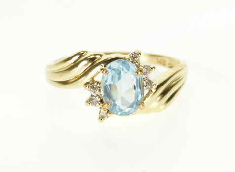 14K Blue Topaz Oval Diamond Accented Wavy Bypass Yellow Gold Ring, Size 8