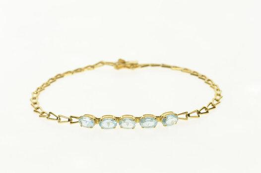 "14K Oval Blue Topaz Inset Arrow Link Yellow Gold Bracelet 7"""