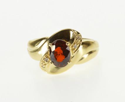 14K Oval Garnet Diamond Accent Wavy Design Yellow Gold Ring, Size 7