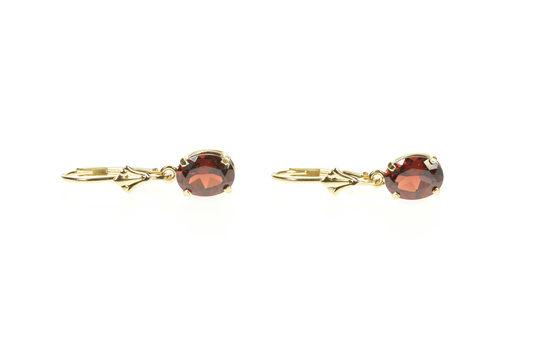 14K Oval Syn. Garnet Dangle Lever Back Yellow Gold Earrings