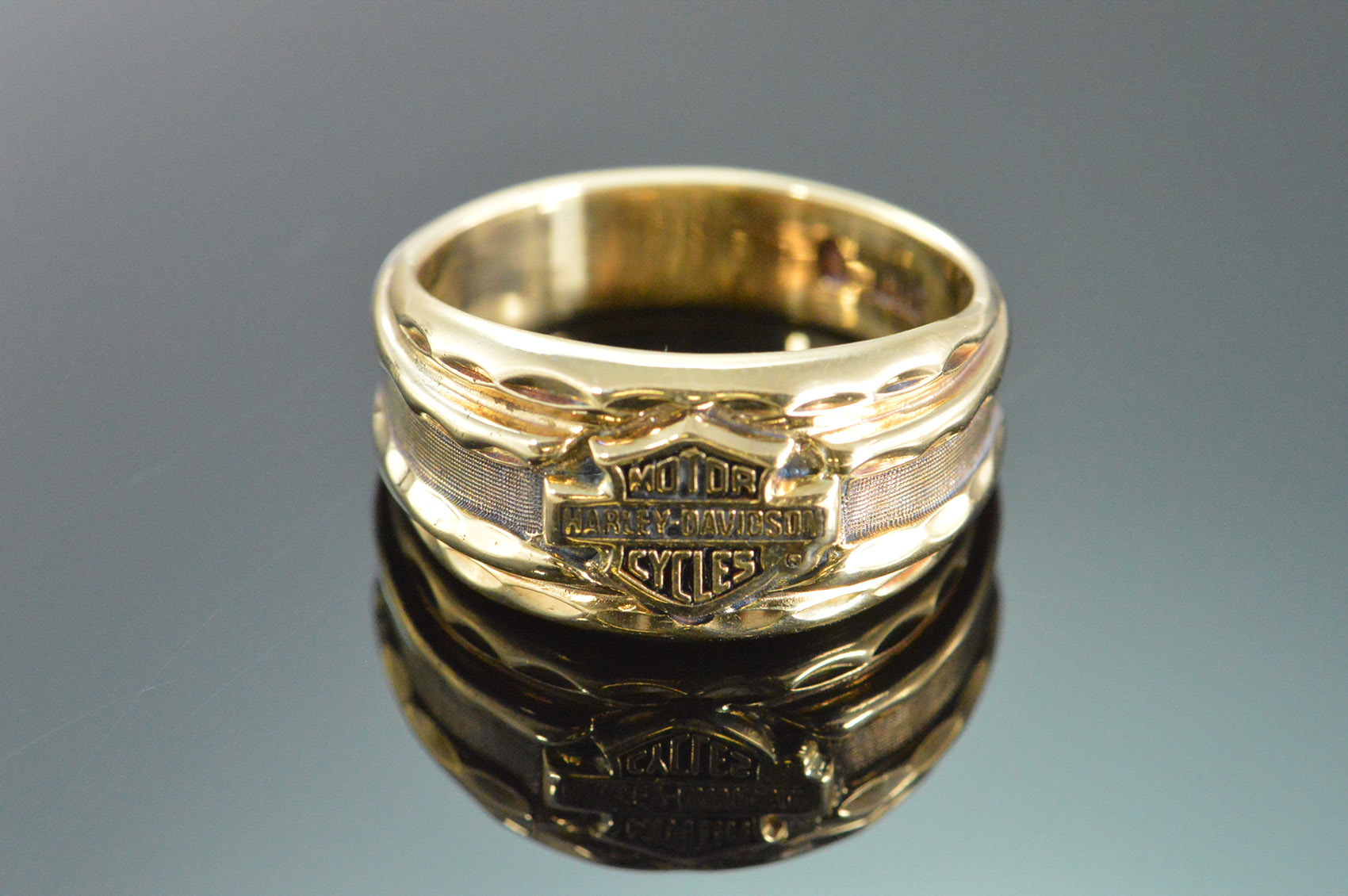 It is a photo of 339K 339.339g Harley Davidson Motorcycle Band Yellow Gold Ring, Size 39