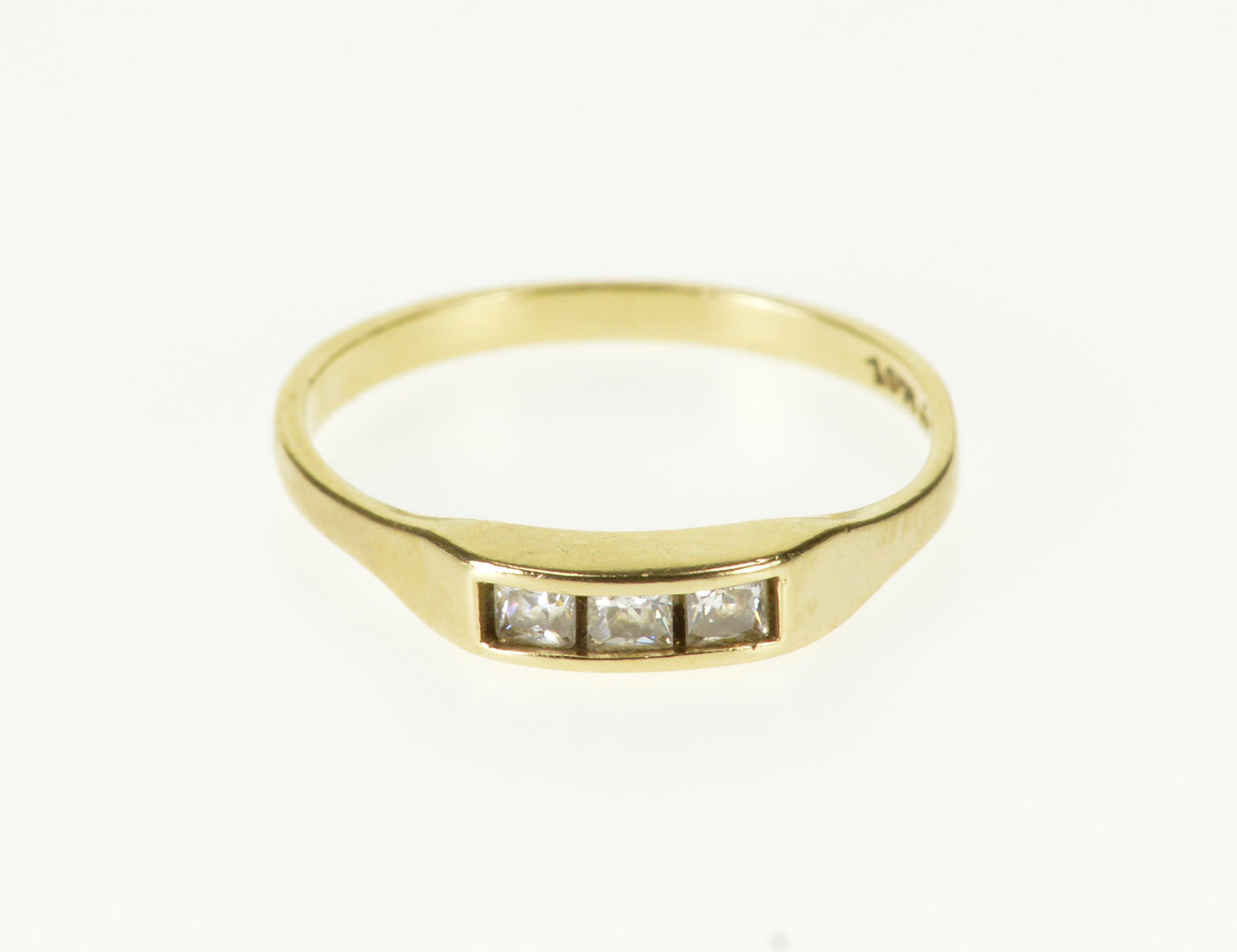 This is a photo of 43K Three Stone Princess Cut Travel Wedding Band Yellow Gold Ring