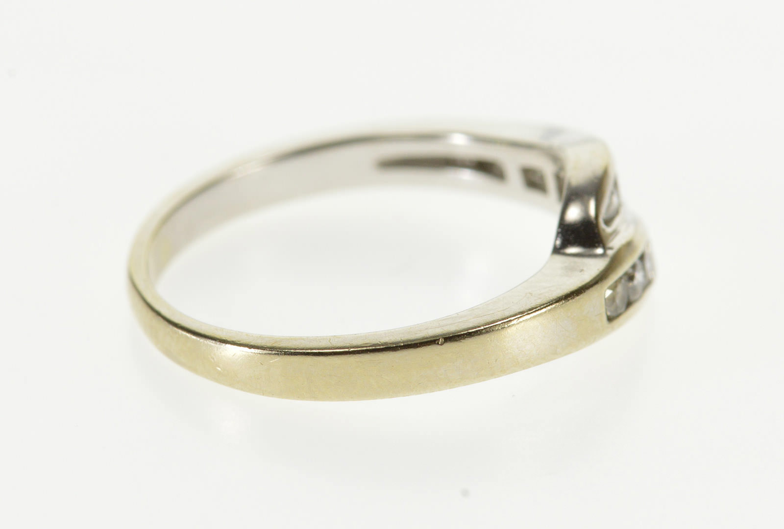 It is a graphic of 43K Channel Round Cut Bypass Travel Wedding Band White Gold Ring