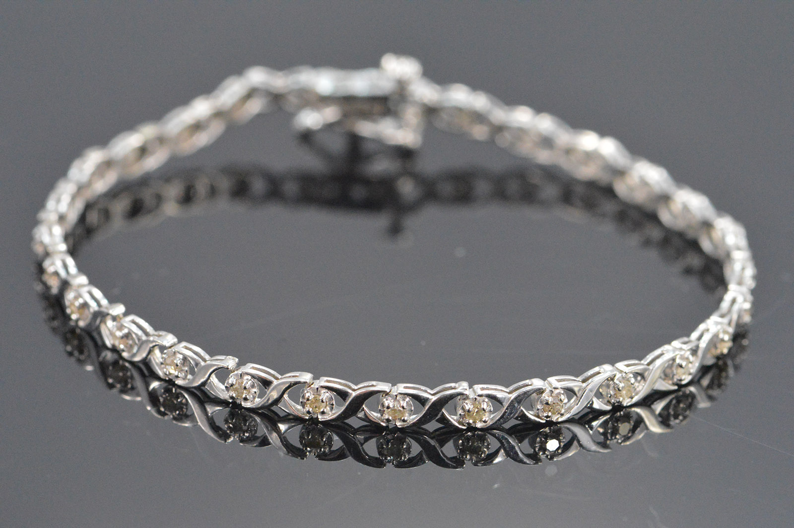 4 4g 10k 0 42 Ctw Diamond X O Tennis Style Bracelet 7 White Gold