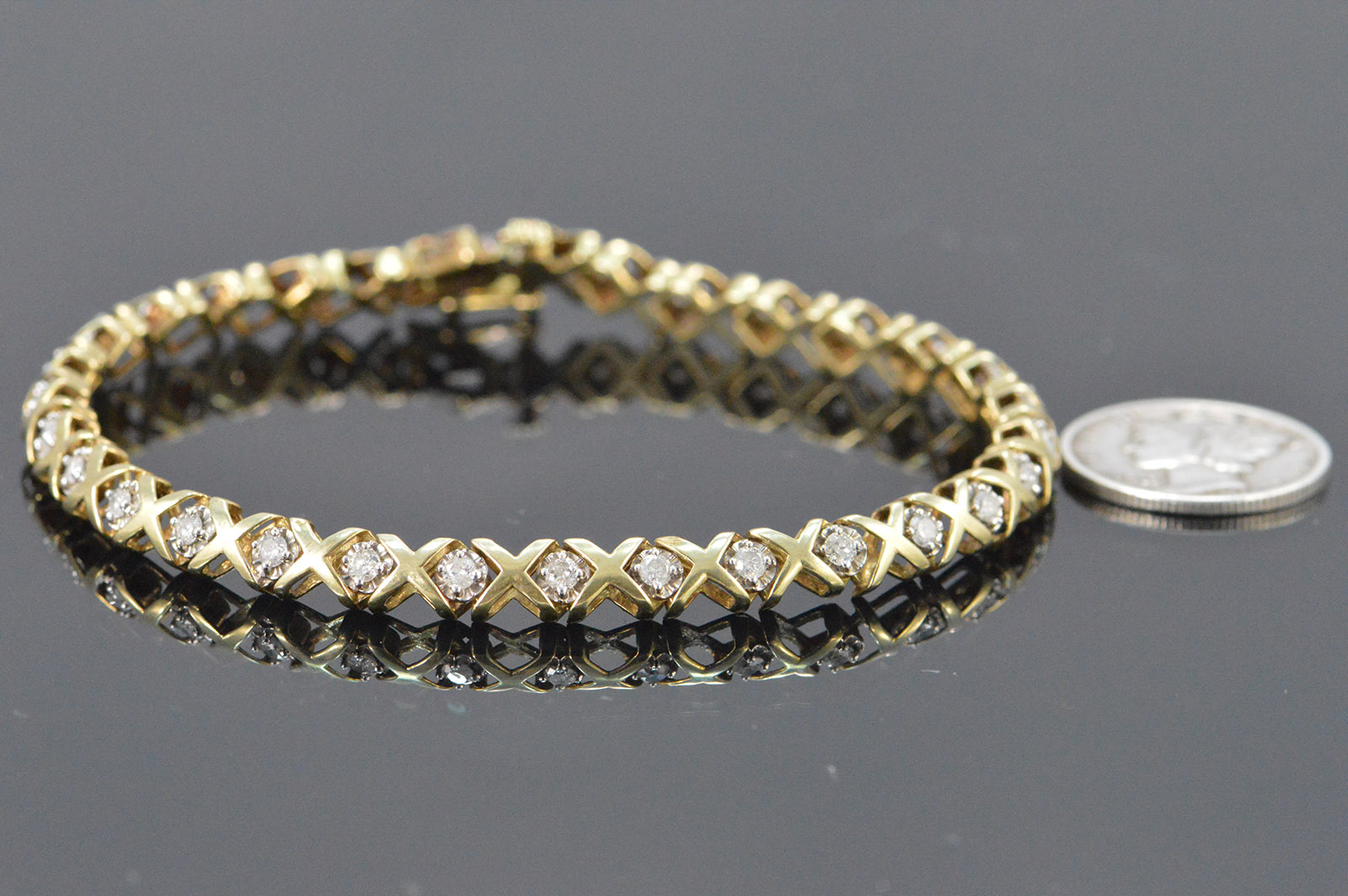 8 8g 10k 0 90 Ctw Diamond X O Tennis Style Bracelet 7 25 Yellow Gold