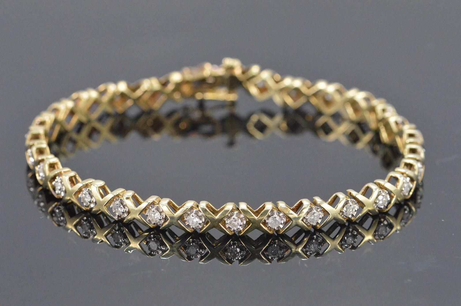 8 8g 10k 0 90 Ctw Diamond X O Tennis Style Bracelet 7 25 Yellow Gold