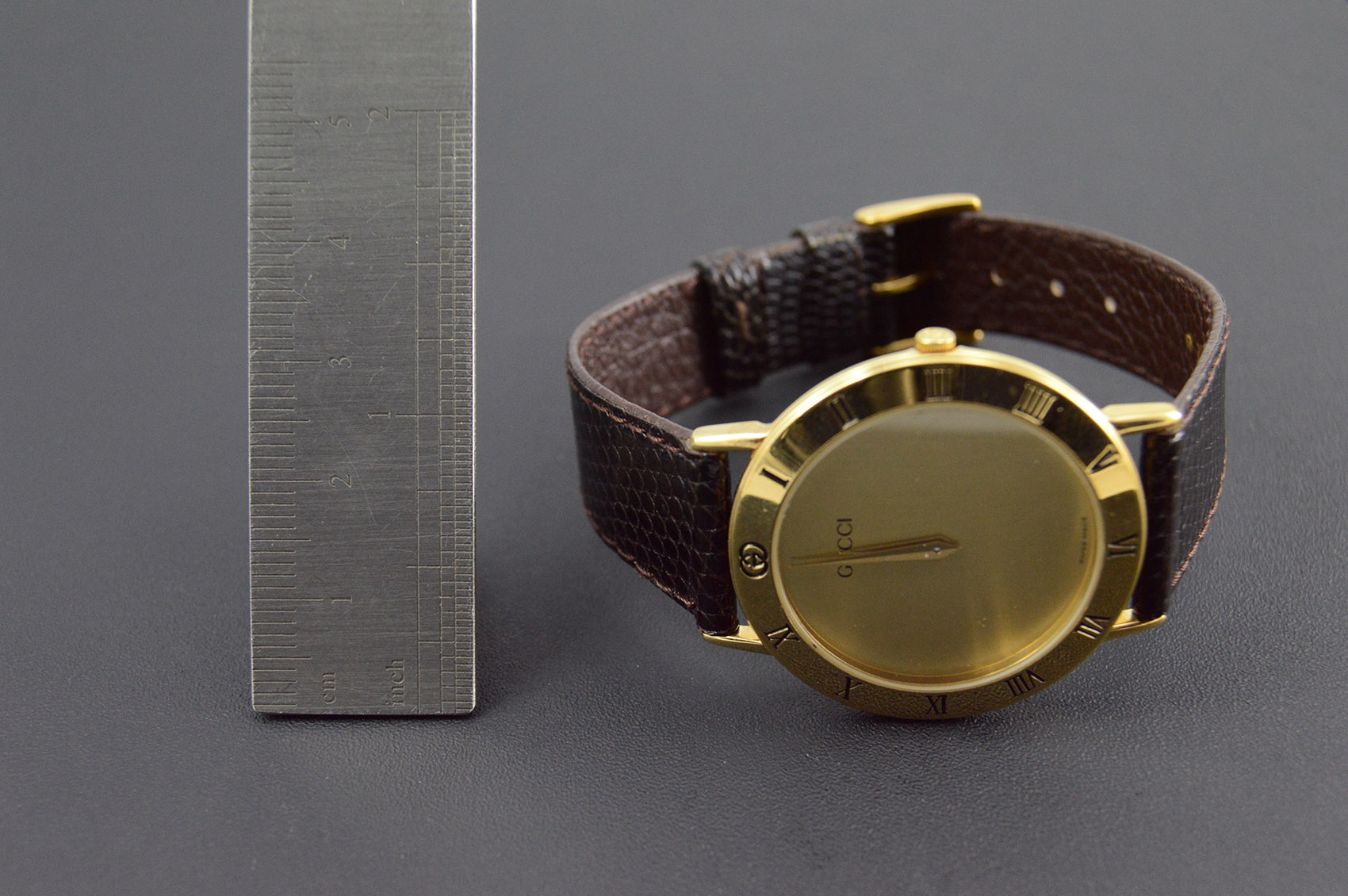 6f07b2ce83a Gucci gold plated round roman numeral black leather face vintage unisex wrist  watch with box jpg
