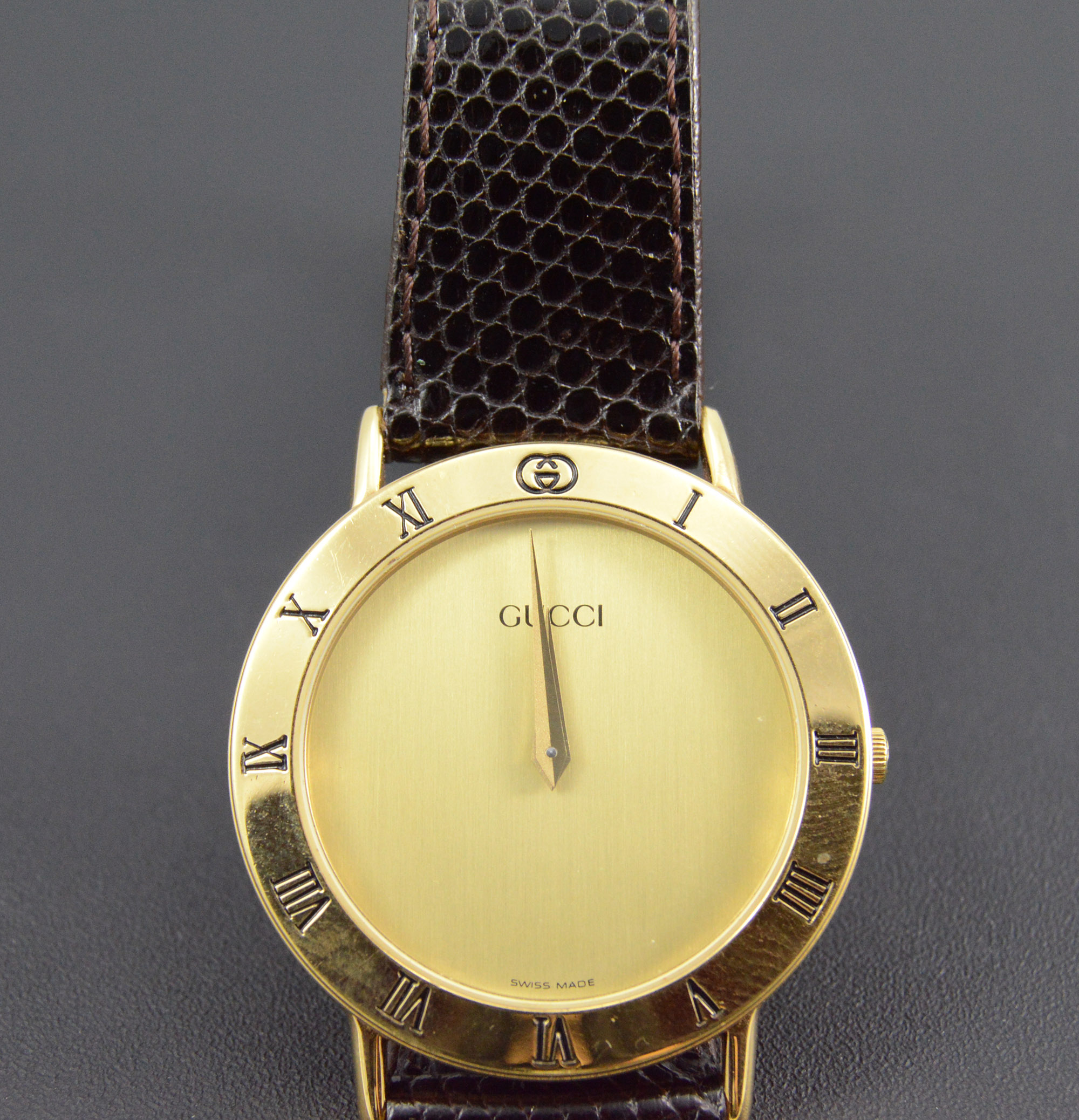 Gucci Gold Plated Round Roman Numeral Black Leather 25.5mm