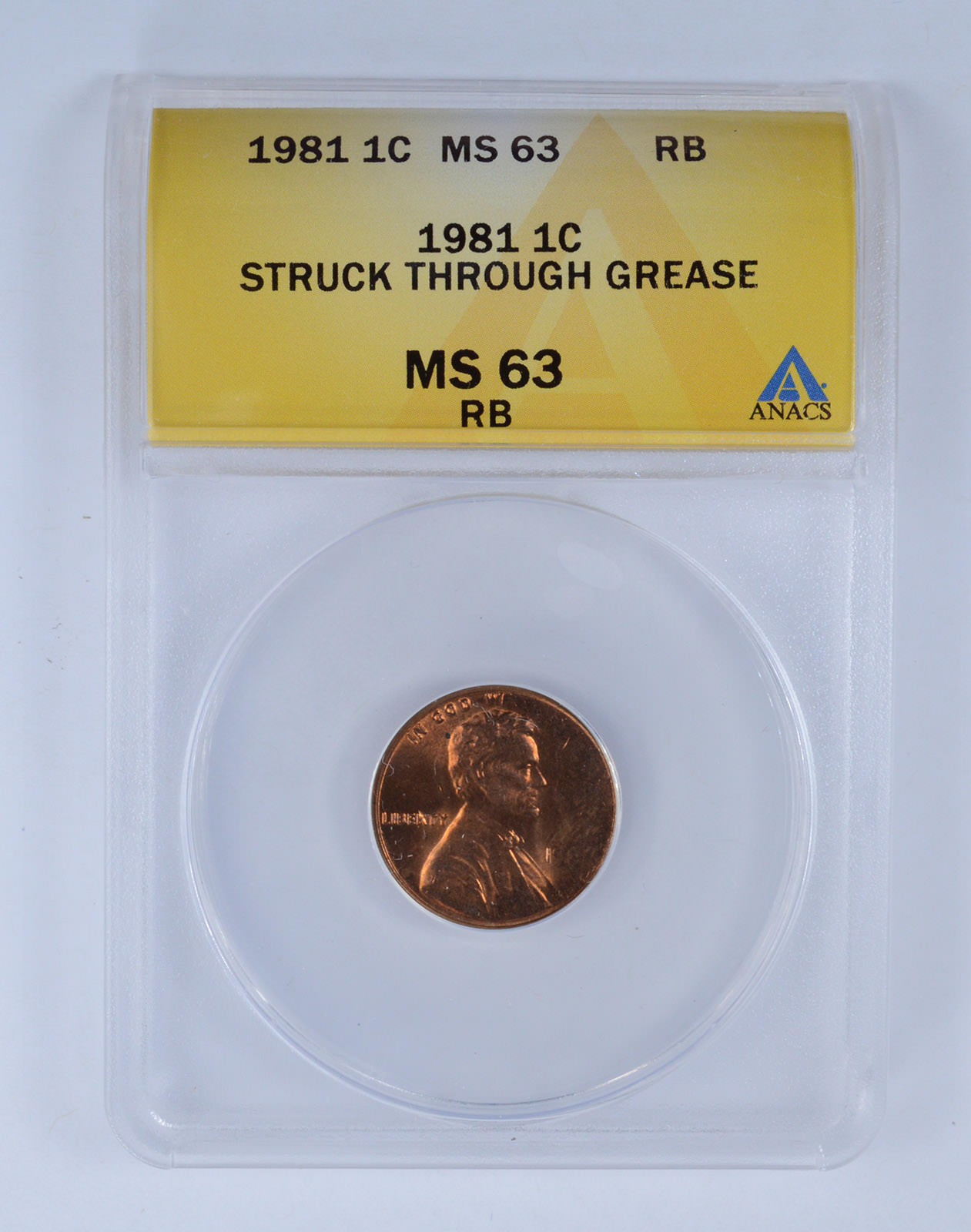 Graded Error - 1981 1C MS63 Red Brown Struck Through Grease