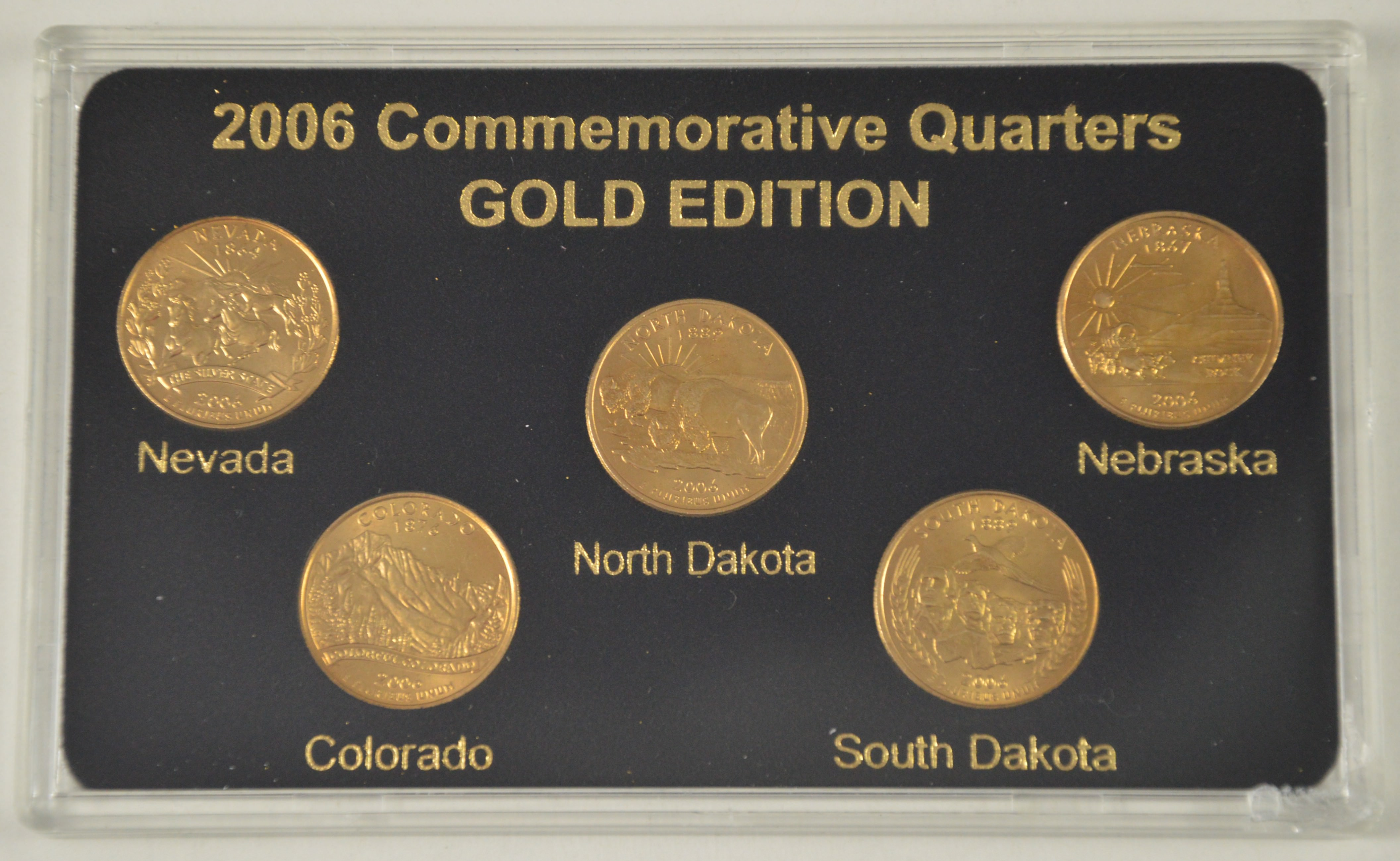 Historic coin collection 2006 commemorative state quarters gold.