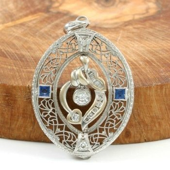 18kt White gold 0.35ct H-I, S1 Diamond, 0.25ct Sapphire Pendant