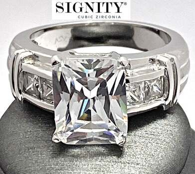 "Celebrity Jewelry Collection .925 Sterling Silver, 9.0ctw ""SIGNITY STAR"" Cubic Zirconia  Ring Size 6"