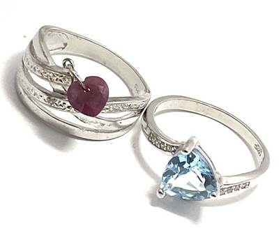 Solid .925 Sterling Silver, 0.01ctw Diamond & 3.0ctw Blue Topaz & 0.55ctw Ruby & 0.10ctw Diamonique Lot of 2 Rings Size 7; 8
