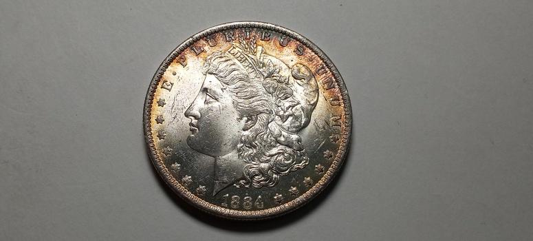 1884 O Morgan Silver Dollar Uncirculated Toned