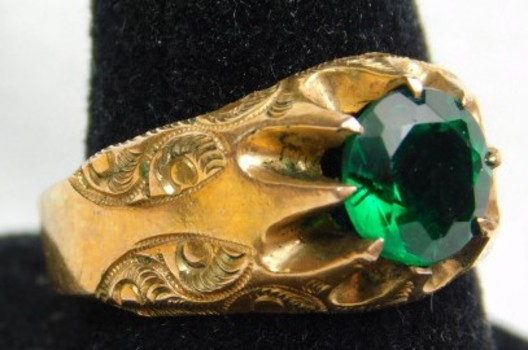 Gold-Colored Ring with Emerald Green Stone - Intricate Design on Band - Size 7 1/2