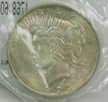 1923 Silver Peace Dollar - Packaged and Graded Unc-60 by the Littleton Coin Co.