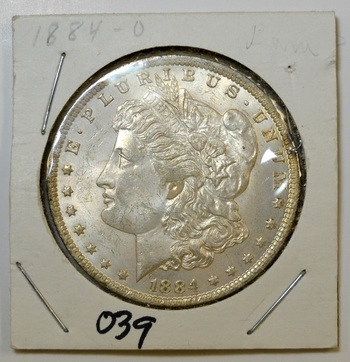 1884-O Morgan silver Dollar in 2x2 holder - Nice Luster!
