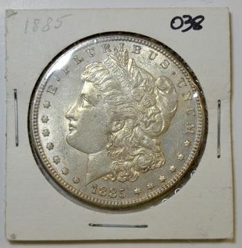 1885 Morgan silver dollar in 2x2 holder