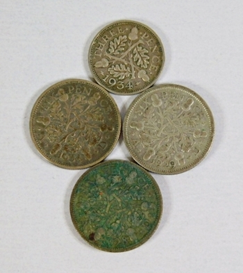 Lot of Four Silver World Coins: Great Britain Three Pence (1934) and Six Pence: 1928, 1929 and 1934