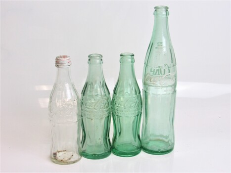 Lot of 4 Coca Cola Bottles Blue Glass Various Sizes
